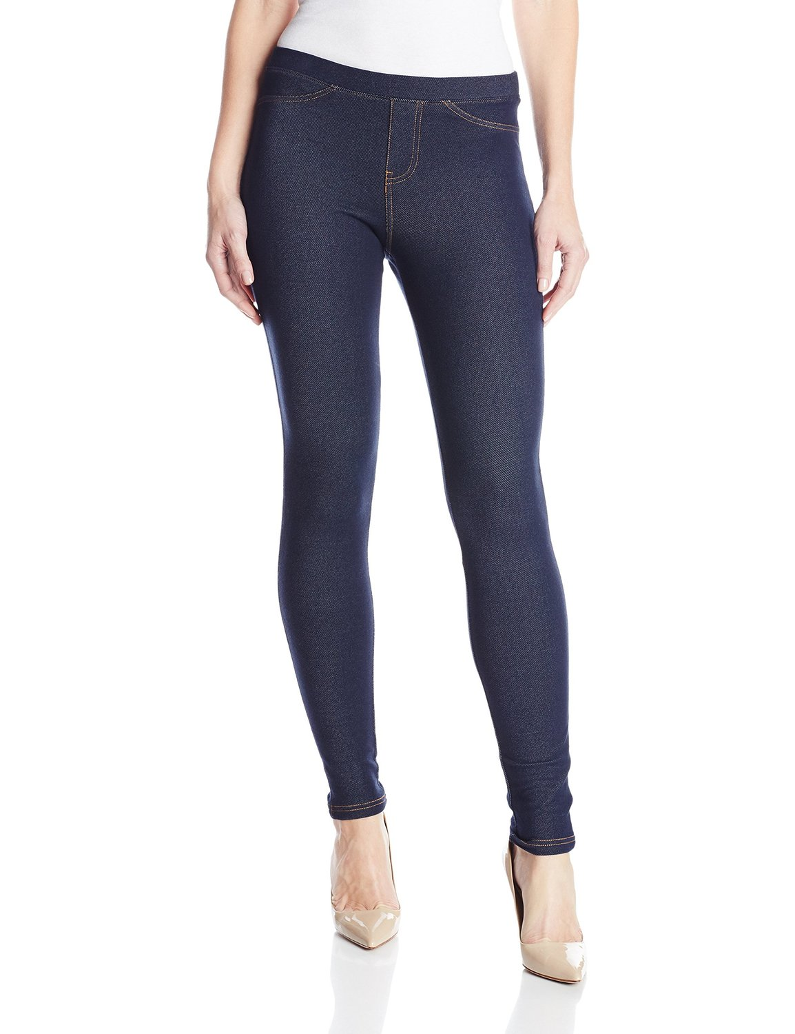 Sleek, form-fitting denim leggings complete with a faux fly and pockets blend comfort with style/5().
